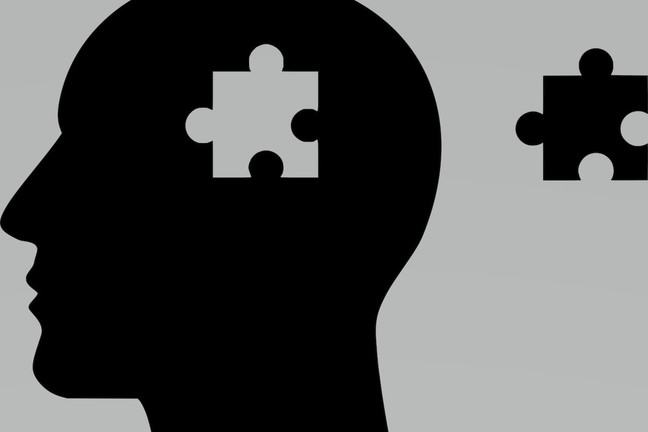 Silhouette of head and jigsaw piece