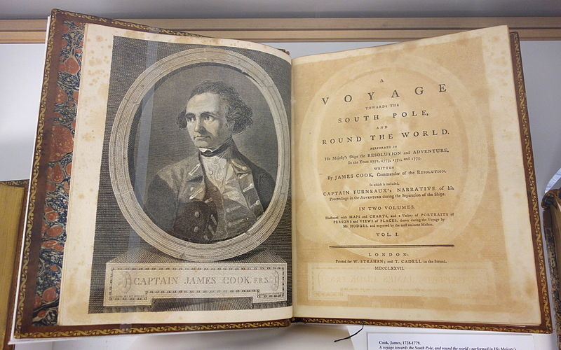 Open book with image of Captain James Cook on left and on right the front page printed. The words say A voyage Toward the South Pole and Round the World