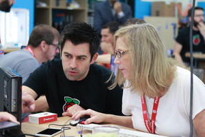 A woman learning object-oriented programming with a man from Raspberry Pi