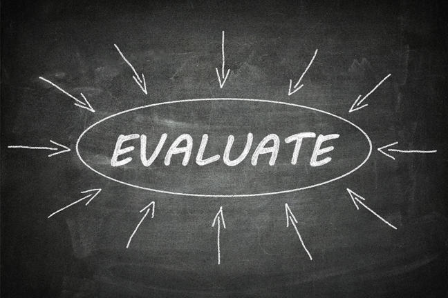 The word Evaluate written on a blackboard