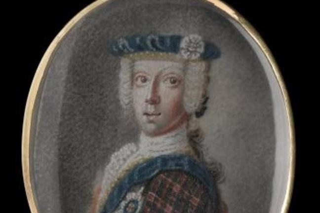 Locket consisting of an oval gold frame with a loop at the top containing a miniature portrait of Prince Charles Edward Stuart, wearing white wig, blue bonnet and white rose, tartan jacket and blue sash.