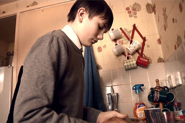 Boy washing up dishes