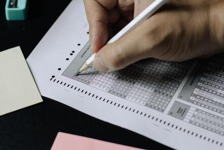 Close up of someone filling in a test paper