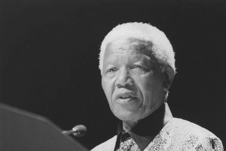 Black and white photograph of Nelson Mandela making a speech.