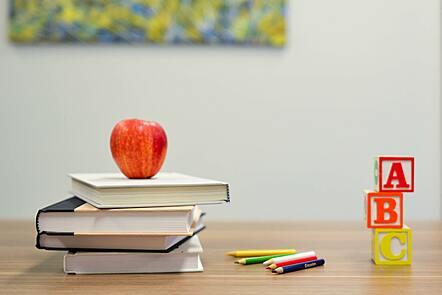 Teacher's desk with books, pencils and building blocks