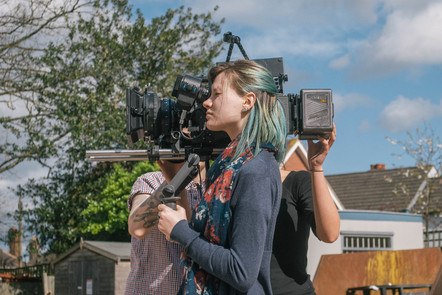 female cinematographer with camera