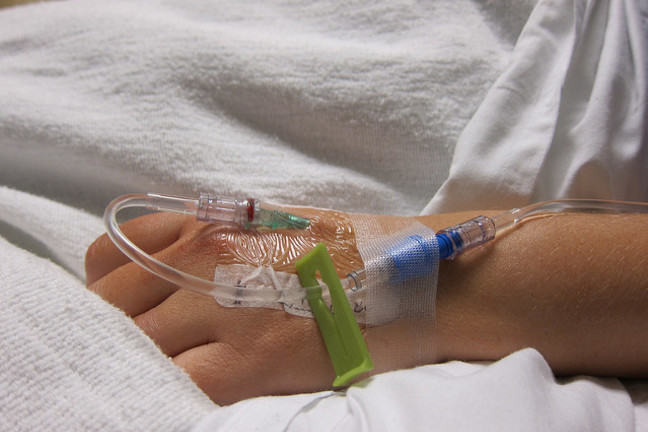 Intravenous drip in patients hand