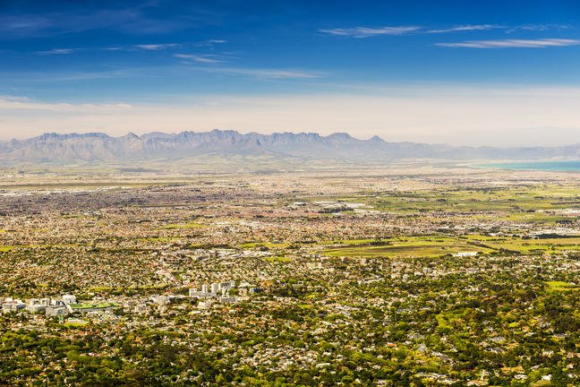 Aerial panorama of Cape Town with urban centres against the backdrop of the Table Mountain range