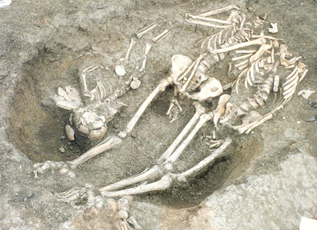 Multiple burials within a single grave.