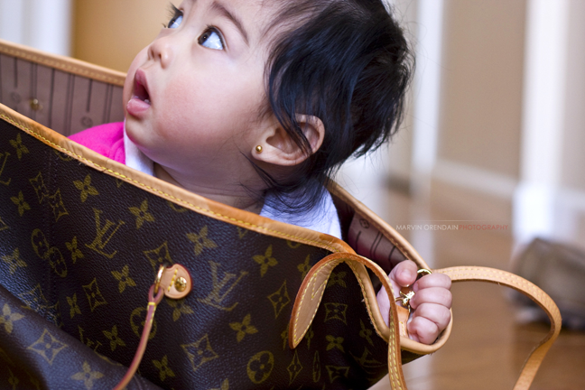 Baby in a designer bag