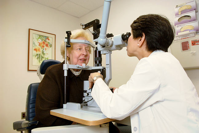 Woman having her retina examined in the clinic
