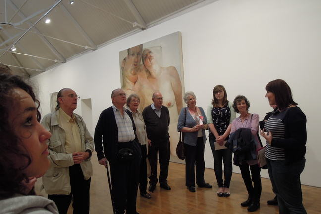 Photograph of a group of people visiting an art exhibition