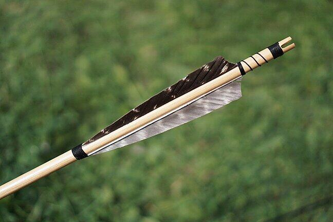 The feathered end of an archer's arrow.