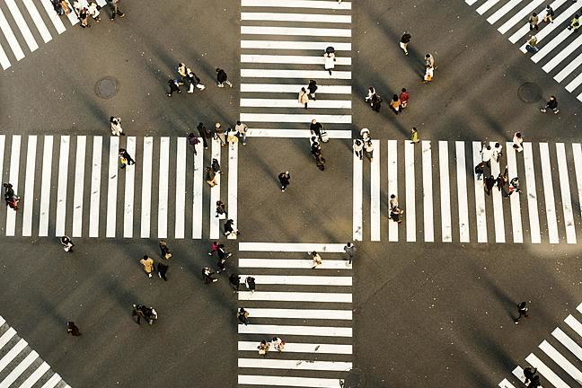 People walking on four zebra crossings