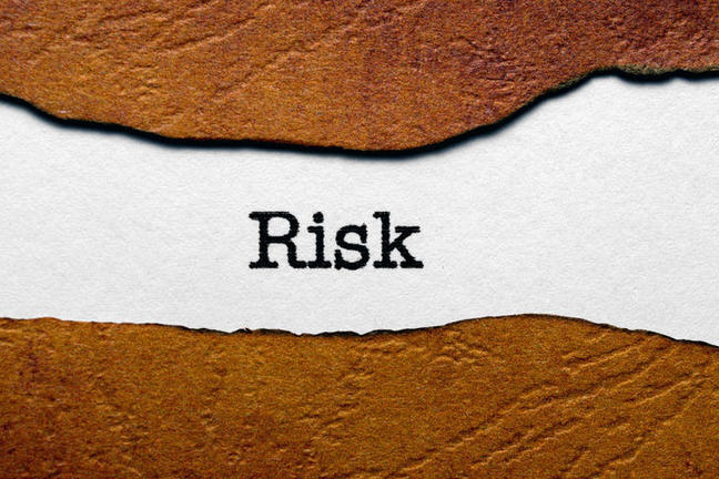 """The word """"risk"""" printed in black on white paper"""