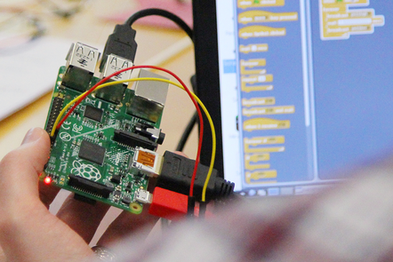 A photograph of someone holding a Raspberry Pi