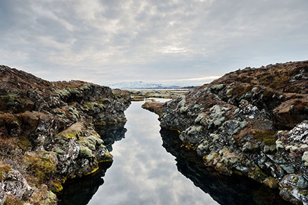 An above-water view of the Silfra fissure, where the tectonic places of North America and Eurasia meet in Thingvellir National Park, Iceland.