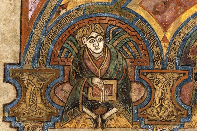 Folio 3v from the Book of Kells, a man holding a book