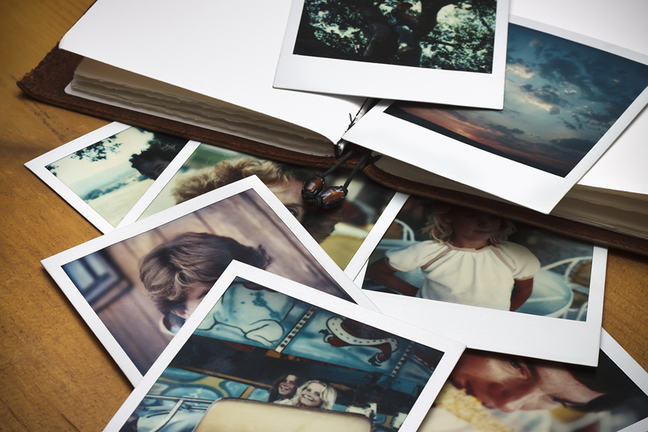 Polaroid photos and book on a table