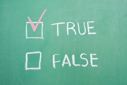 True and false written on a board in chalk, with a tick next to true.