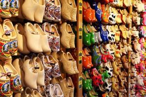 Lots of Dutch clogs hanging on a wall
