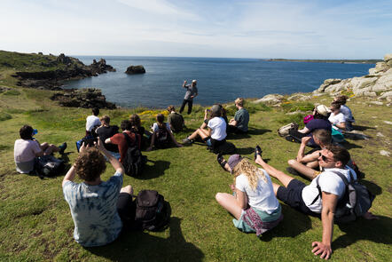 students on Scilly listening to a lecturer