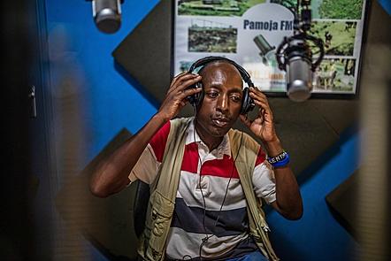 Man in studio wearing headphones