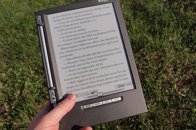 Photograph of hand holding an ebook reader