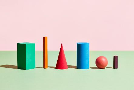 Colourful shaped blocks, rectangular, triangular and spherical.