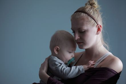 Mother holding baby looking sad