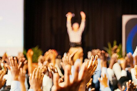 Audience with hands up