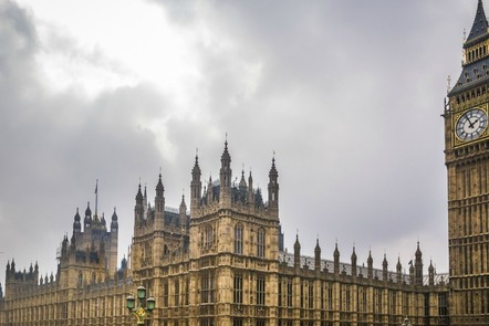 A photograph of the Houses of Parliament underneath a grey sky