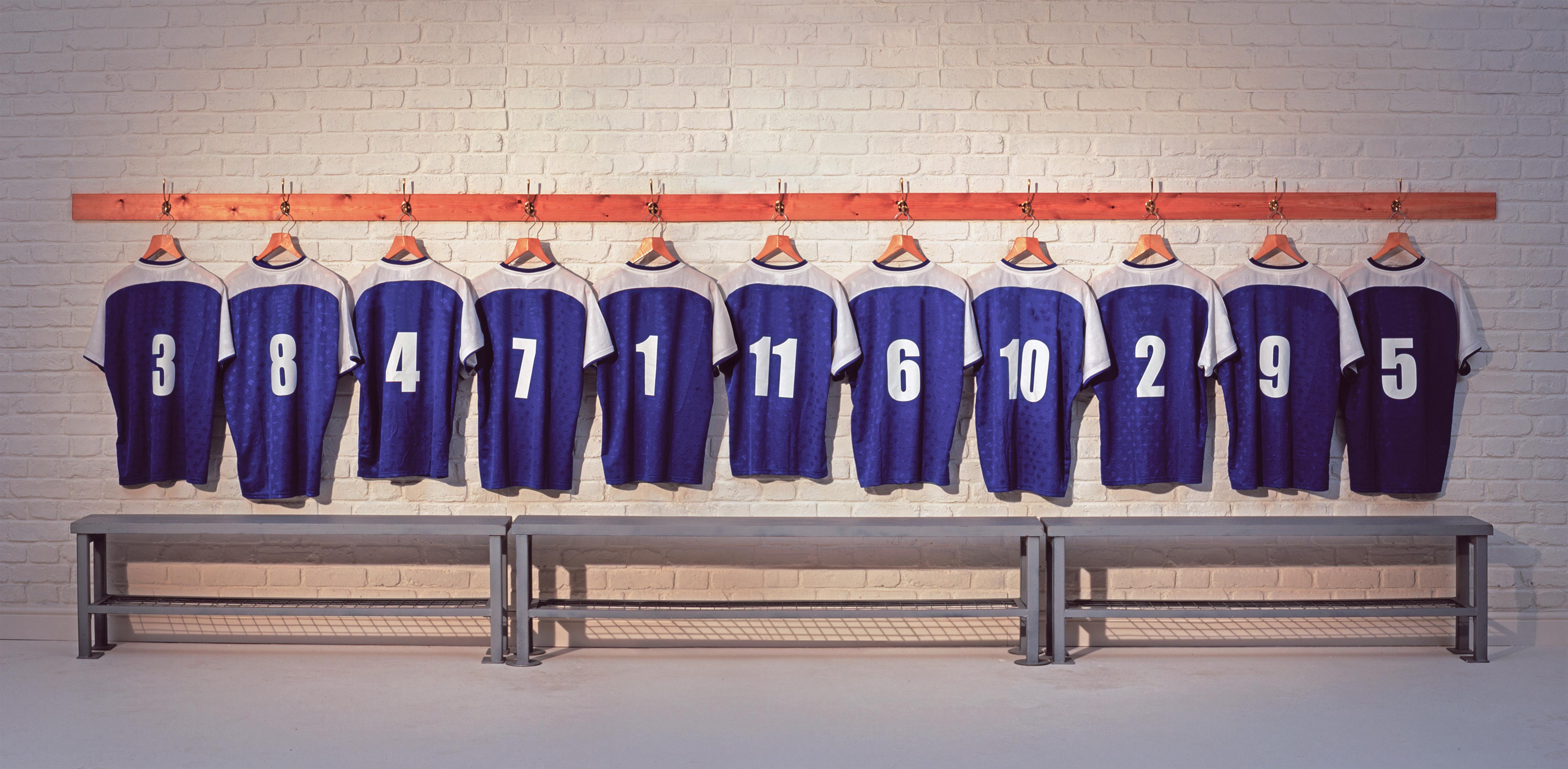 Row of football shirts hanging up