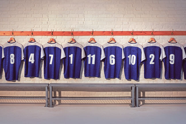 Row of football shirts hanging up
