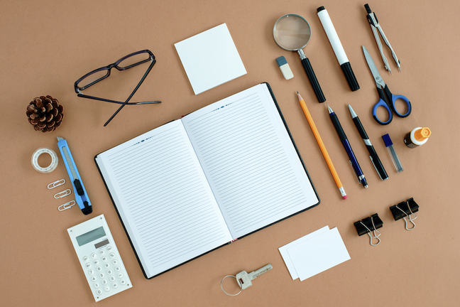 lots of study resources on a table - a pad, pencils, calculator - tools for learning