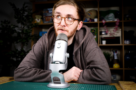 A user speaking into a microphone