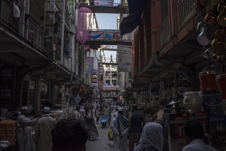 People navigate a busy street in the bazaar in Kabul's old city neighbourhood.