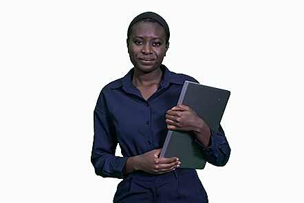 A university student standing and holding a black laptop.