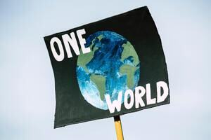 A sign that says 'one world'