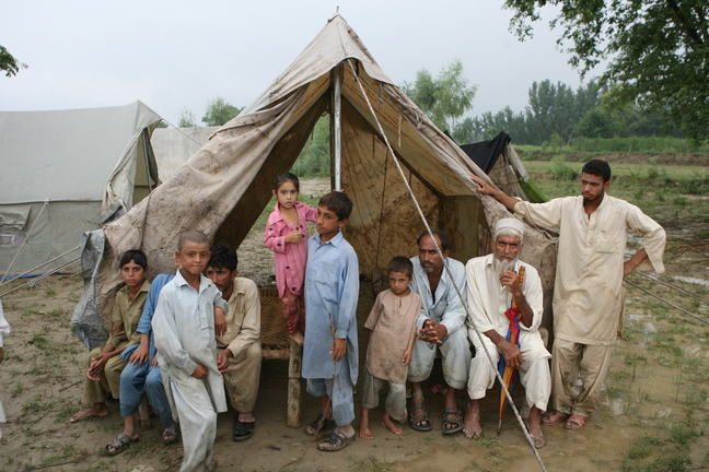 Family taking shelter in tent after Pakistan 2010 flood