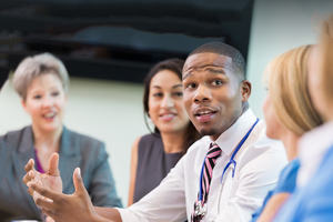 A group of healthcare professionals in conversation