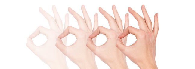 A series of hands making a sign language gesture