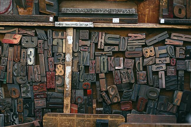 A variety of printing press blocks are displayed in this photograph.