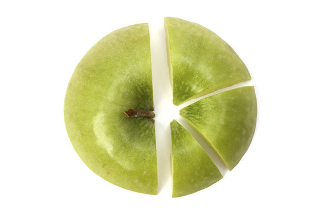 Photo of an apple that's been cut into pieces