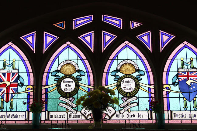 Photograph of stained-glass window paying tribute to fallen soldiers.