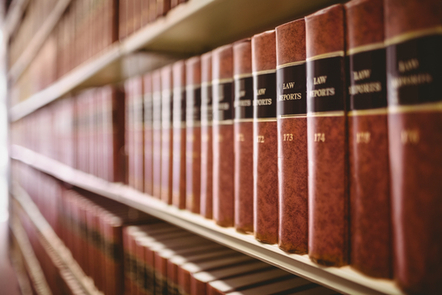 Leather-bound books on a bookshelf. They are titled 'Law Reports'.