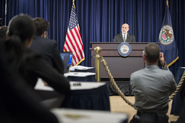 Chairman Ben S. Bernanke takes a reporter's question at a press conference on December 12, 2012.