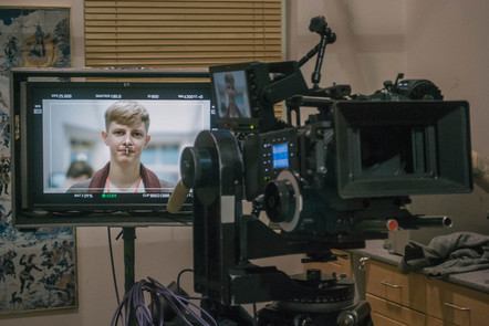 Arri Alexa camera with an image of a young man's face on its screen.