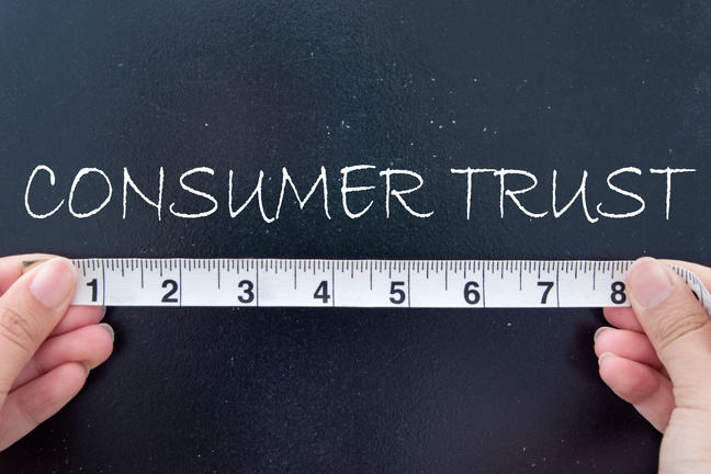 "The word ""consumer trust"" written in white on a black board"