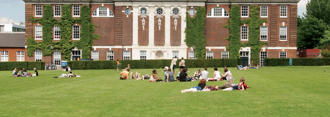 Students relaxing on the university green